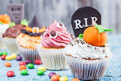 Halloween cupcakes with different colored mastic decorations Stock Photos