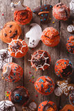 Halloween cupcakes and gingerbread cookies closeup. vertical top Royalty Free Stock Images