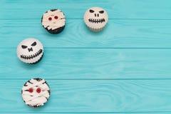 Halloween cupcakes. Mummy and jack-head cupcake. Halloween treat stock photos