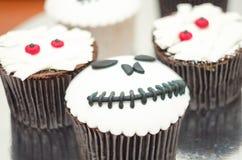 Halloween cupcakes. Mummy and jack-head cupcake. Halloween treat royalty free stock photo