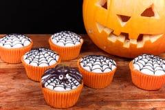 Halloween cupcakes and pumpkin Stock Image