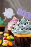 Halloween cupcakes on rustic wooden background Stock Images