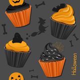 Halloween Cupcakes Seamless Pattern. A Halloween seamless pattern with sweet cupcakes, isolated on gray background. Useful also as design element for texture Royalty Free Stock Image