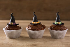 Halloween cupcakes with witch hat. Background stock images
