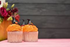 Halloween cupcakes. Witch`s hat cupcake. Halloween treats on woo stock images