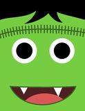 Halloween cute green monster face Stock Images