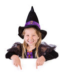 Halloween: Cute Little Witch Points Down From Behind White Card Stock Photos