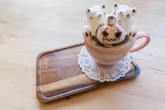 Halloween 3D coffee latte art. With polar bears and angry pumpkin ghost Stock Photos
