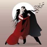 Halloween Dance Party. Romantic vampire couple dancing. Stock Photo