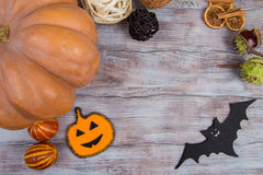 Halloween decor: vegetables and decorations on the wooden background. Top view Stock Photo