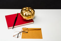 Halloween decor on white table over black background. Royalty Free Stock Photography