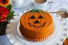 Halloween decorated cake served on ceramic plate. Royalty Free Stock Photography