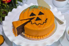 Halloween decorated cake served on ceramic plate. Stock Photos