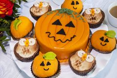 Halloween decorated cakes served on ceramic plate. Stock Images