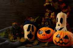 Halloween decorated pumpkins on dark rustic background, copy spa Royalty Free Stock Photo
