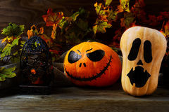 Halloween decorated pumpkins on dark rustic background stock photography