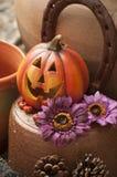 Halloween decoration. Orange ceramic pumpkin with a wicked smile Stock Image
