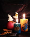 Halloween Decoration. Candles, ghost at black background stock images