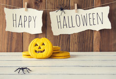 Halloween decoration. Background: spiders and some pumpkins. Happy Halloween is hanging on a rope with clothespins. Vintage Style royalty free stock photos