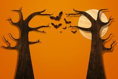 Bats flying and tree made from wood on orange brick wall Royalty Free Stock Image