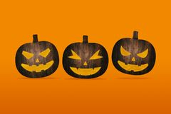 Pumpkins made from wood on orange background Royalty Free Stock Photography