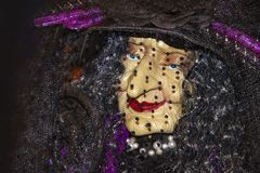Halloween decoration elegant old witch face closeup under a veil and wearing pearls and red lipstick stock photos