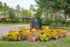 Halloween decoration in a garden of a community village entertainment center. Halloween decoration (with USA national flag) in a garden of a community village royalty free stock photography