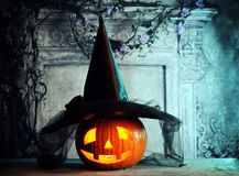 Halloween decoration. Halloween pumpkin with witch hat Royalty Free Stock Photo