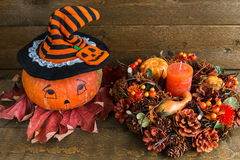 Halloween decoration: painted pumpkin and autumn garland. Above view Royalty Free Stock Photo