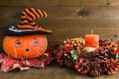 Halloween decoration: painted pumpkin and autumn garland. Front view Royalty Free Stock Photography