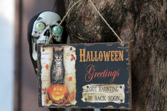 Halloween decoration. Scary Halloween sign and skull hanging from a tree. patio decoration for the home stock photography