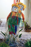 The halloween decoration - two straw girls dolls. Stock Photo
