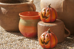 Halloween decorations. Orange ceramic pumpkin with a wicked smile Stock Image