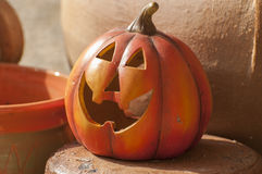Halloween decorations. Orange ceramic pumpkin with a wicked smile Royalty Free Stock Images