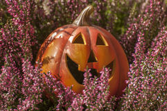 Halloween decorations. Orange ceramic pumpkin with a wicked smile Royalty Free Stock Photography