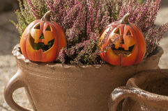 Halloween decorations. Orange ceramic pumpkin with a wicked smile Stock Photo