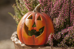 Halloween decorations. Orange ceramic pumkin with a wicked smile Royalty Free Stock Photography