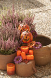 Halloween decorations. Orange ceramic pumkin with a wicked smile Royalty Free Stock Photos