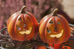 Halloween decorations. Orange ceramic pumkin with a wicked smile Royalty Free Stock Images