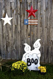 Halloween decorations along an old barn. Stock Photos