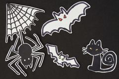 Halloween decorations cat, spider, bat and spiderweb Royalty Free Stock Photos