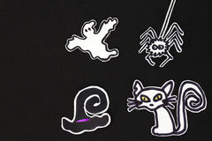 Halloween decorations  cat, witch hat, ghost and spider Stock Photo