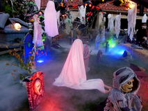 Halloween decorations. Ghosts and goblins decorating yard outside house for Halloween Stock Photo