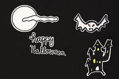 Halloween decorations  house bats, moon, clound and Happy Hallow. A horizontal overhead view of a Halloween scene: a house and a bat with a moon and clouds and a Royalty Free Stock Image