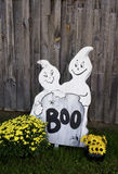 Halloween decorations stand in front of an old barn. Stock Image