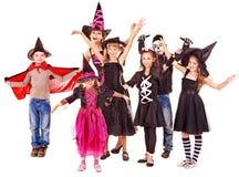 Halloween deltagare med gruppungen. Royaltyfri Foto