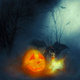 Halloween and the demon of hell. The symbol of Halloween and the cemetery, very scary hellish demon spewing fire Royalty Free Stock Photo