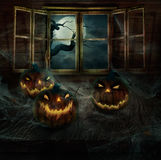 Halloween Design - Abandoned pumpkins. Holiday horror background with  Pumpkins, spider webs, and full moon with spooky tree Stock Photo
