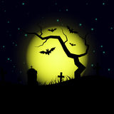 Halloween design background with spooky graveyard, naked tree, graves and bats Royalty Free Stock Photo