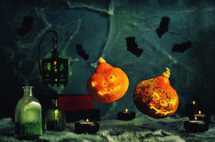 Halloween design with flying pumpkins. Horror background with a. Spider& x27;s web, candles, potions and bats. Space for your holiday text on Halloween Stock Photos